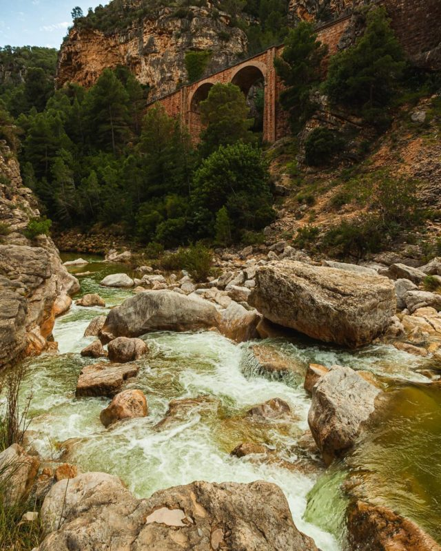 The gorge at La Fontcalda, which translates to hot spring; I'd like to say we kayaked down these rapids, but our aquatic adventures were limited to a quick bath in the spring (rather liberal use of the word hot, as it turns out; tepid may be more accurate). #rapids #Spain #spaintravel #travel #traveleurope #bridge #lafontcalda #river