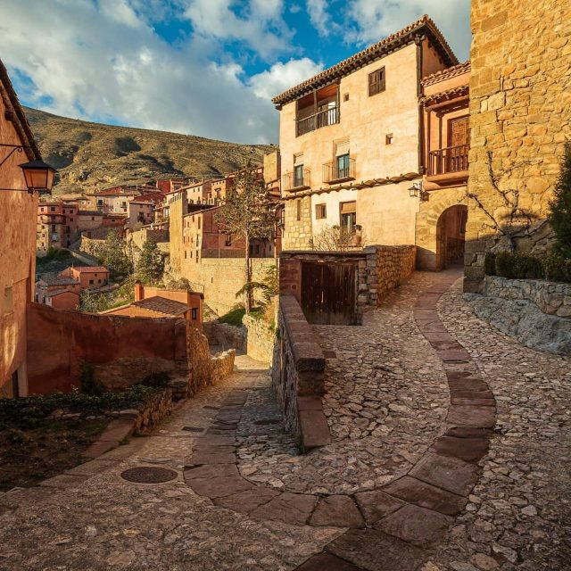 The backstreets of Albarracin in Spain. This stunning medieval town was made a national monument in 1961, and it's not hard to see why. We spent days exploring and getting lost in the maze of narrow alleyways and charming streets here.  #stayhome #Albarracin #Spain #spaintravel #travel #traveleurope #traveltheworld #justnotrightnow